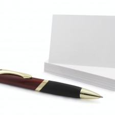 Blank visit card with pen isolated