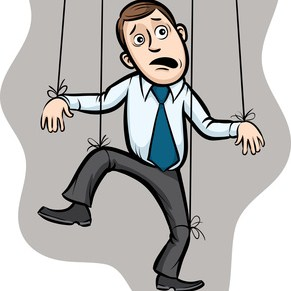 Businessman as a puppet on strings