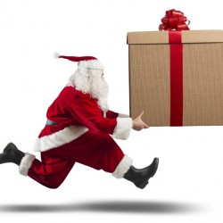 Running Santa Claus with big gift